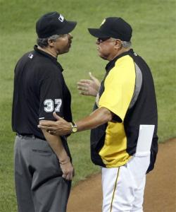 Pittsburgh Pirates manager Clint Hurdle, right, argues with third base umpire Gary Darling after Darling called Chicago Cubs' Brett Jackson safe in the sixth inning of a baseball game Friday, Sept. 7, 2012, in Pittsburgh. Hurdle was ejected from the game.
