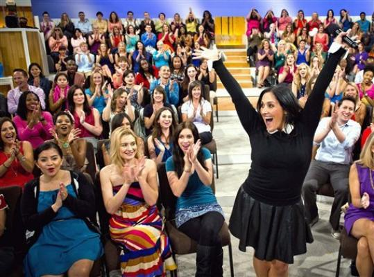 FILE - This Wednesday, July 25, 2012 photo released by 20th Television shows host Ricki Lake with her audience during the first day of taping for her new daytime talk show, 'The Ricki Lake Show,' in Los Angeles. The nationally syndicated show, which will cover topics ranging from parenting, weight loss, health, beauty, career, and love, premieres on Sept. 10.