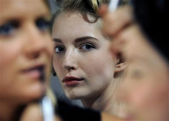 A model waits backstage before the showing of the Billy Reid Spring 2013 collection during Fashion Week, Friday, Sept. 7, 2012, in New York.