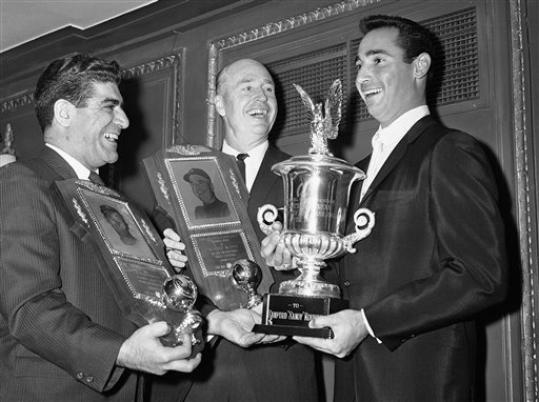 FILE - In this Jan. 12, 1964, file photo, Los Angeles Dodgers pitcher Sandy Koufax, right, stands with manager Walt Alston, center, and Associated Press sportswriter Joe Mooshil in Chicago during a Chicago baseball writers' awards dinner. Mooshil, who became a fixture on the Chicago sports scene over the course of four decades covering the city's teams for The Associated Press, died Friday night, Sept. 7, 2012. He was 85. Maria Mooshil, his daughter, said he died at St. Francis Hospital in suburban Evanston after a brief illness and the cause of death was sepsis and complications of chronic lymphocytic leukemia.