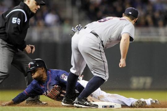 Minnesota Twins center fielder Ben Revere beats the tag by Cleveland Indians third baseman Jack Hannahan to steal third as part of a double steal in the third inning of a baseball game, Saturday, Sept. 8, 2012, in Minneapolis. Umpiring is Dan Iassogna.