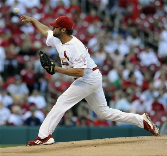 St. Louis Cardinals' starting pitcher Jake Westbrook throws against the Milwaukee Brewers in the first inning in a baseball game on Saturday, Sept. 8, 2012, at Busch Stadium in St. Louis.