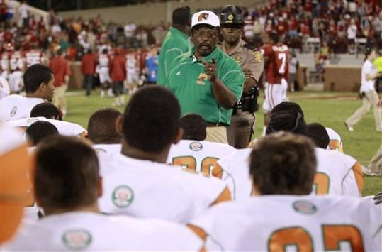 Florida A&M coach Joe Taylor talks to his team following their 69-13 loss to Oklahoma in an NCAA college football game in Norman, Okla., Saturday, Sept. 8, 2012.