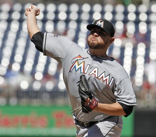 Miami Marlins starting pitcher Ricky Nolasco throws during the first inning of a baseball game against the Washington Nationals at Nationals Park, Sunday, Sept. 9, 2012, in Washington.