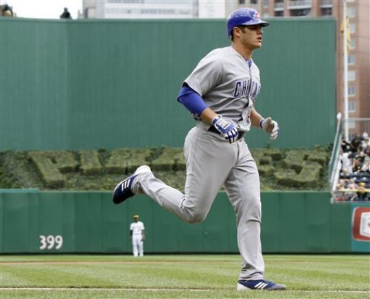 Chicago Cubs' Anthony Recker trots around the bases after hitting the Cubs' second home run of the fourth inning of a baseball game against the Pittsburgh Pirates on Sunday, Sept. 9, 2012, in Pittsburgh.