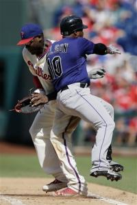 Colorado Rockies' Chris Nelson, right, collides with Philadelphia Phillies first baseman Ryan Howard on a ground-out in the sixth inning of the first game of a baseball doubleheader on Sunday, Sept. 9, 2012, in Philadelphia. Philadelphia won 3-2.