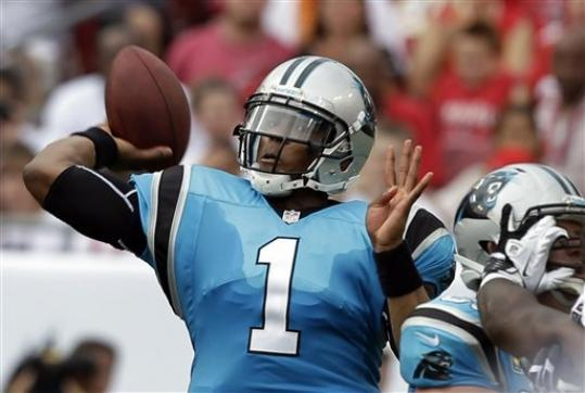 Carolina Panthers quarterback Cam Newton throws a pass during the first quarter of an NFL football game against the Tampa Bay Buccaneers, Sunday, Sept. 9, 2012, in Tampa, Fla.