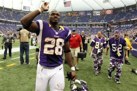 Minnesota Vikings running back Adrian Peterson celebrates as he run off the field after his team's 26-23 overtime win over the Jacksonville Jaguars in an NFL football game, Sunday, Sept. 9, 2012, in Minneapolis.