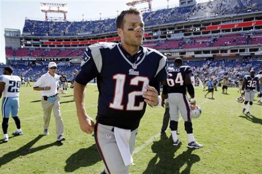 New England Patriots quarterback Tom Brady (12) leaves the field after defeating the Tennessee Titans 34-13 in an NFL football game, Sunday, Sept. 9, 2012, in Nashville, Tenn.