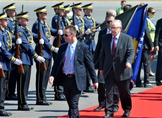 Former Finnish President and Nobel peace prize winner Martti Ahtisaari, right, reviews Kosovo Security Force honor guard as he arrives in Kosovo capital Pristina on Monday, Sept. 10, 2012. Western powers members of the International Steering Group, which has overseen Kosovo since its 2008 unilateral declaration of independence from Serbia are set to announce the end of supervision over the territory.