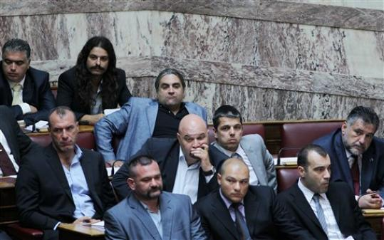 FILE - In this Friday, June 29, 2012 file photo shows lawmakers of the Golden Dawn extreme far-right party during a vote for deputy speakers at the Greek Parliament, in Athens. Greece's public order ministry on Monday, Sept 10, 2012 is withdrawing police guards who have been protecting the lawmakers of an extreme far-right party that has vowed violent intimidation against immigrant street vendors.