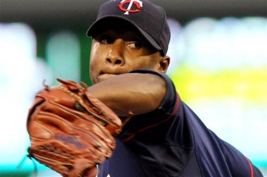Minnesota Twins starting pitcher Samuel Deduno (21) throws against the Cleveland Indians during the first inning of a baseball game, Monday, Sept. 10, 2012, in Minneapolis.