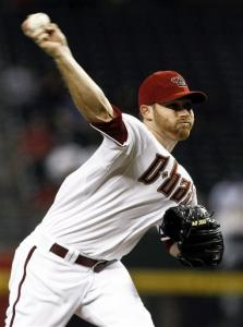 Arizona Diamondbacks' Ian Kennedy throws against the Los Angeles Dodgers during the first inning of a baseball game, Tuesday, Sept. 11, 2012, in Phoenix.