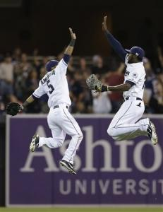 San Diego Padres second baseman Alexi Amarista, left, and center fielder Cameron Maybin, right, celebrate after beating the St. Louis Cardinals during their baseball game Tuesday, Sept. 11, 2012, in San Diego. The Padres won, 6-4.