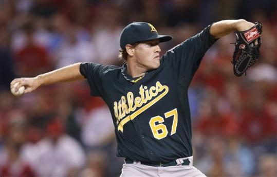 Oakland Athletics starting pitcher Dan Straily throws against the Los Angeles Angels in the first inning of a baseball game in Anaheim, Calif., Tuesday, Sept. 11, 2012.