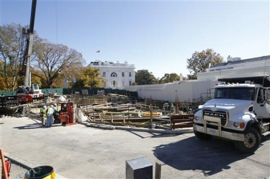FILE - In this Nov. 9, 2011, file photo, construction continues in front of the West Wing at the White House in Washington. The White House Big Dig is finally wrapping up, but the Big Reveal is proving to be a pretty big letdown. After nearly two years and $86 million worth of noisy and disruptive construction, the West Wing has emerged from its visual seclusion remarkably unchanged. And deep underground, whatever has been built there remains shrouded in mystery.
