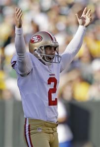 San Francisco 49ers kicker David Akers reacts after kicking a 63-yard field goal during the first half of an NFL football game against the Green Bay Packers Sunday, Sept. 9, 2012, in Green Bay, Wis. Akers tied an NFL record with the field goal.