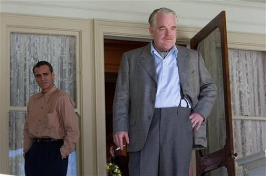 This film image released by The Weinstein Company shows Joaquin Phoenix, left, and Philip Seymour Hoffman in a scene from 'The Master.' The film will be presented at the 37th Toronto International Film festival running through Sept. 16.