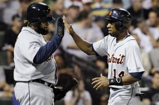 Detroit Tigers' Austin Jackson, right, celebrates with Prince Fielder after scoring on a single hit by Miguel Cabrera during the fifth inning of a baseball game against the Chicago White Sox in Chicago, Wednesday, Sept. 12, 2012.