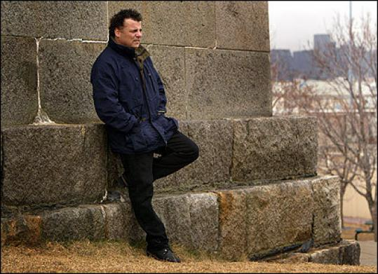 Kevin Weeks stood atop the hill of Castle Island overlooking Boston Harbor, where he spent many days with James Bulger.