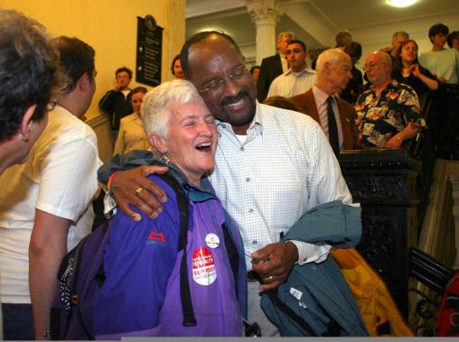 Pat Gozemba (left) of Salem left was embraced by David Wilson, one of the original plaintiffs in the landmark same-sex marriage lawsuit. The pair celebrated after the vote outside the House chamber.