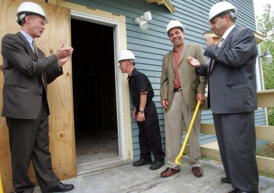 Lauding work on Triangle's group home were (from left) Town Manager Wayne Marquis, resident Gerard Torre, agency CEO Mike Rodrigues and state Representative Theodore Speliotis.