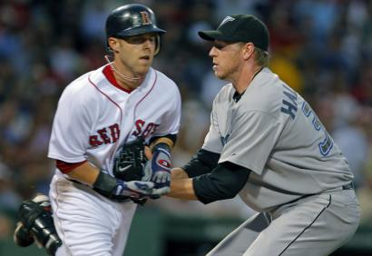 Neither Dustin Pedroia nor Roy Halladay cared to watch this fourth-inning encounter. Halladay was roughed up by Boston's bats, surrendering five earned runs in five innings.