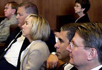 Notre Dame football coach Charlie Weis (second left); his wife, Maura, and Massachusetts General Hospital surgeons Richard Hodin, and Charles Ferguson (right) at Weis's second medical malpractice lawsuit trial at Suffolk Superior Court in Boston yesterday.
