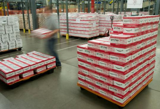 An Amazon.com employee in Fernley, Nev., stacks boxes containing the final installment of the Harry Potter series. The book is scheduled to go on sale Saturday at 12:01 a.m.