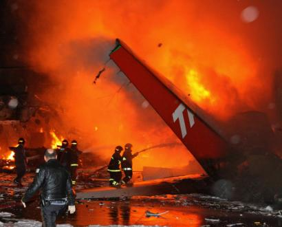 Firefighters worked to put out the fire consuming the wreckage of a Tam airlines passenger plane that crashed yesterday while landing at Congonhas Airport in Sao Paulo .