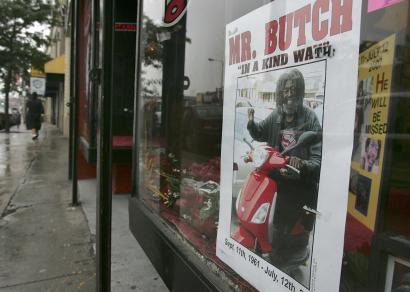 In the window of Regeneration Records & Tattoos, a memorial was set up for Harold Madison Jr., a panhandler known as Mr. Butch, who died in a motor scooter accident last week.