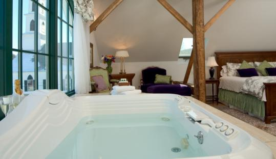 Bathe yourself with views of the Green Mountains and the town of Newfane, Vt., from Suite Four at Four Columns Inn.