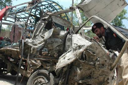 A Pakistani police officer examined the wreckage of a vehicle used by a suicide bomber to attack a police academy in Hangu, in northwest Pakistan, killing seven people. Yesterday was the fifth consecutive day of deadly attacks in Pakistan.