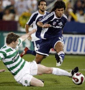 Juan Toja of FC Dallas goes over Celtic FC's Kenny Miller en route to his first-half goal in the All-Star Game in Colorado.
