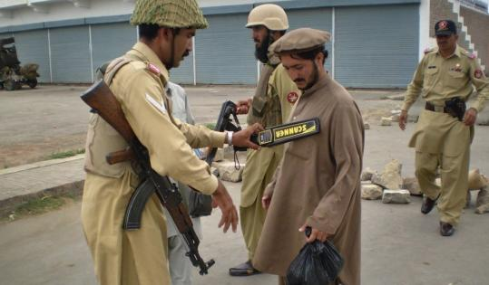 Pakistani paramilitary soldiers searched a tribesman after security was beefed up in Miranshah, the main town in the North Waziristan tribal region last week.
