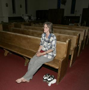 Carol Tumasz prepared to spend the night in the chapel of St. Therese Church in Everett last week. She arrives there by 7:30 most nights.