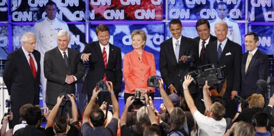 From left, Democratic presidential candidates Mike Gravel, Chris Dodd, John Edwards, Hillary Clinton, Barack Obama, Bill Richardson, Joseph R. Biden Jr., and Dennis Kucinich before last night's debate at The Citadel in Charleston, S.C.