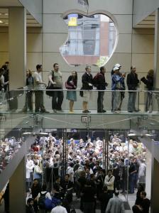 Customers line up outside the Apple Store in Chicago to be among the first to buy an iPhone last month. Chairman Steve Jobs expects the iPhone to become the company's third major business.