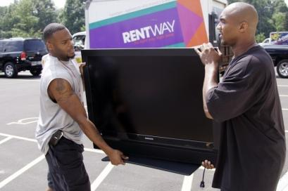 Buffalo's Kiwaukee Thomas (left) and Kevin Harrison move a television into the team's dormitory before training camp.