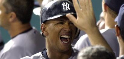 Yankees slugger Alex Rodriguez celebrates with his teammates in the dugout after belting career home run No. 499 in the eighth inning at Kansas City.