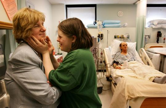 Carole Kelley shares a moment with daughter Shannon while husband, Mark, receives dialysis at Newton-Wellesley Hospital.