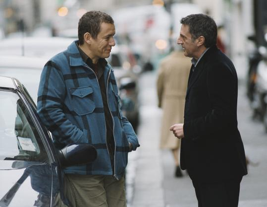 Dany Boon (left) plays a lonely cab driver who teaches Daniel Auteuil's Francois about friendship in Patrice Leconte's film.