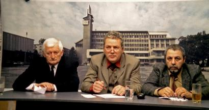From left: Mircea Andreescu, Teo Corban, and Ion Sapdaru discuss the 1989 revolution in Romania on a low-rent TV call-in show in '12:08 East of Bucharest.'