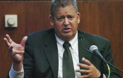 Charlie Weis, shown on the stand Wednesday in Suffolk Superior Court, said he won't appeal the jury's verdict that cleared doctors of malpractice in his gastric bypass surgery in 2002. Weis, former Patriots assistant coach, said had he won, he would have donated any damages to a charity for people with special needs. 'Our family decided to retry this case based on principle, not money,' he said.