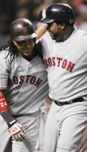 Manny Ramírez and David Ortiz are arm in arm after Ramírez's second homer.