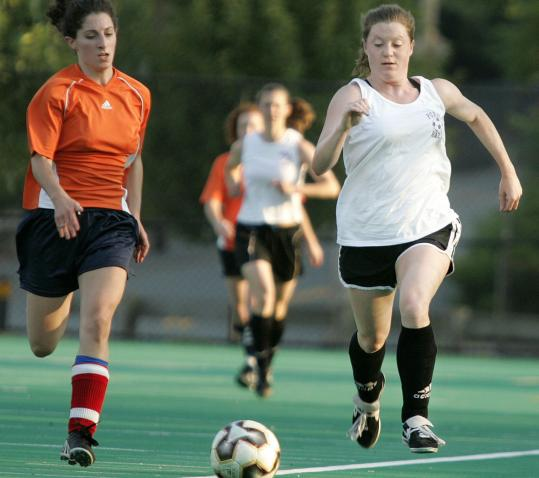 Lauren Kelly (right), an event planner, plays soccer at Reservation Park in Boston.