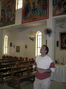 Iraqi artist Nebil Anwar has his paintings displayed at a church in Zarghe, Jordan. Anwar fled Iraq to avoid violence.