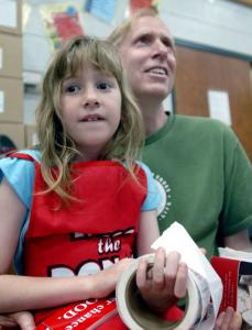 Claire Kelly, 8, sat with her father, Kevin, as he waited to donate blood at the annual Frances Kelly Blood Drive.