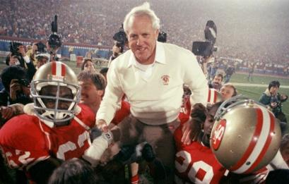 San Francisco 49ers coach Bill Walsh was hoisted on the shoulders of his team after they defeated the Miami Dolphins 38-16 in Super Bowl XIX.