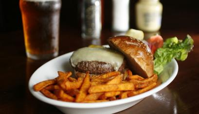 A burger with sweet-potato fries is a great choice at the Biltmore.